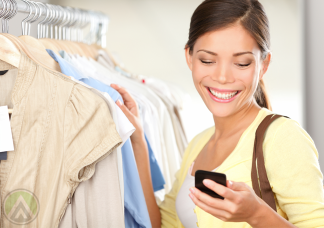 female-shopper-clothes-shopping-looking-at-smartphone
