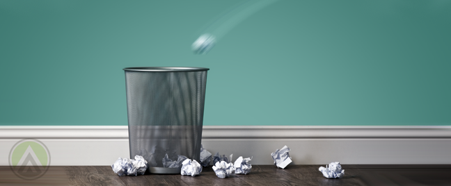trash-bin-along-teal-wall-with-crumpled-paper