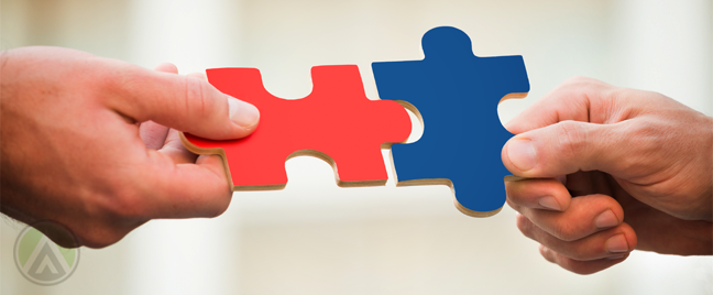 businessmen-hands-holding-fitting-jigsaw-puzzle-pieces