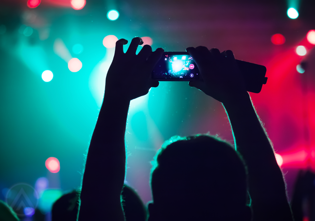 concert-attendee-holding-up-smartphone