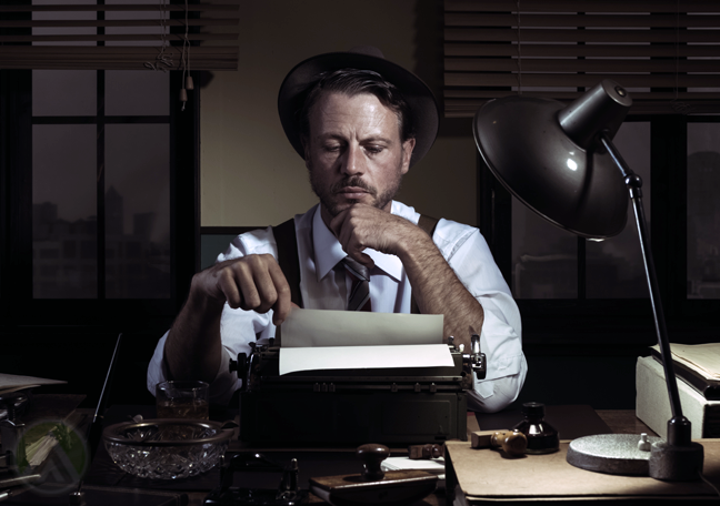 old-timey-writer-in-the-dark-with-typewriter