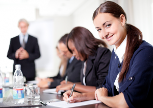 smiling-female-employee-in-a-corporate-training