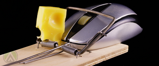 computer-mouse-on-moust-trap-with-cheese