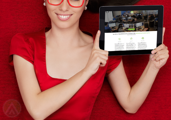 woman-in-red-glasses-dress-in-red-backdrop-holding-tablet