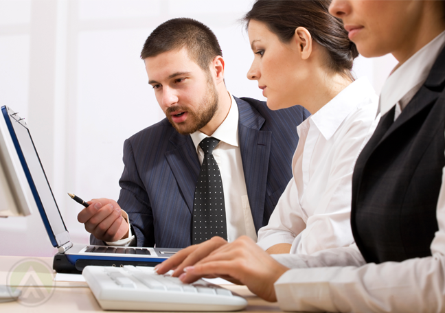 business-team-discussing-documents-on-laptop