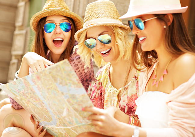 girls-in-summer-wear-chatting-looking-at-map