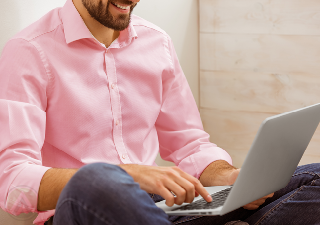 smiling-bearded-man-sitting-using-laptop