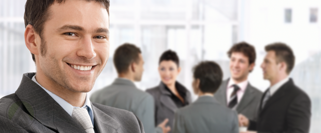 smiling-businessman-with-business-team-meeting-in-back