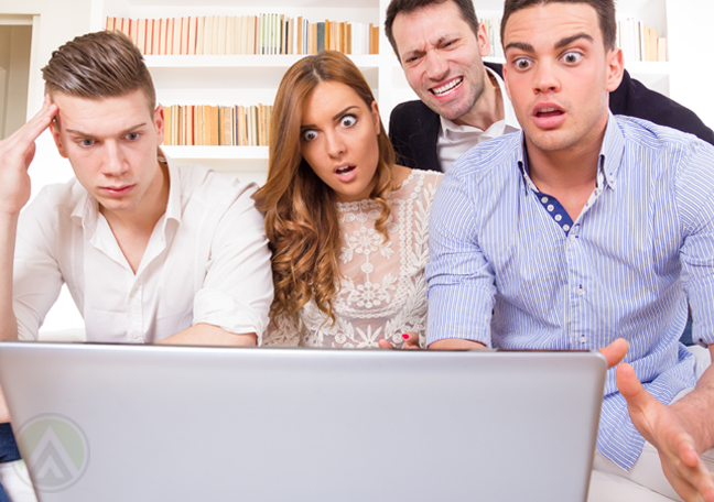 surprised-young-group-watching-laptop
