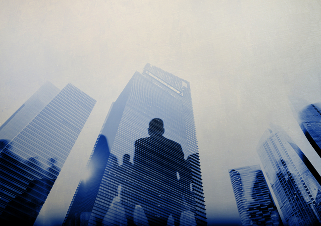 tall-buildings-with-businessmen-sillhouettes