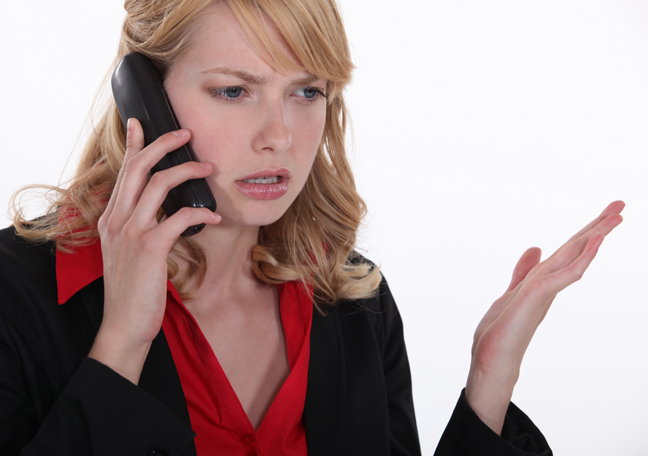 confused-female-business-executive-on-a-phone-call