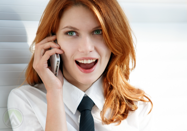 female-red-head-gossiping-on-the-telephone