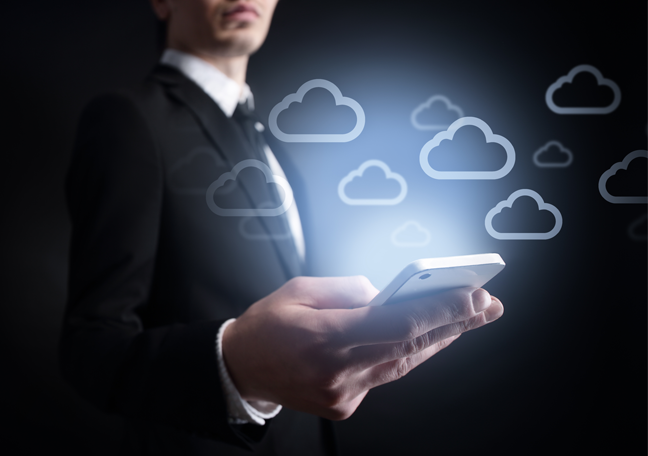business-executive-using-smartphone-with-cloud-icons-in-dark