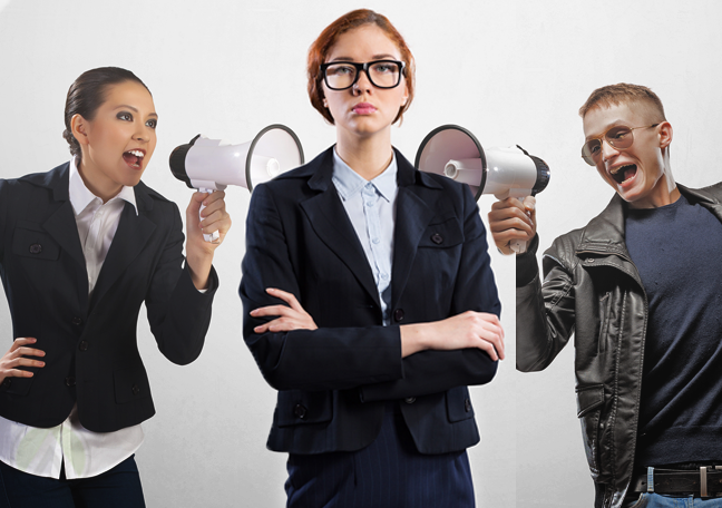 businesswoman-in-glasses-ignoring-people-with-megaphones