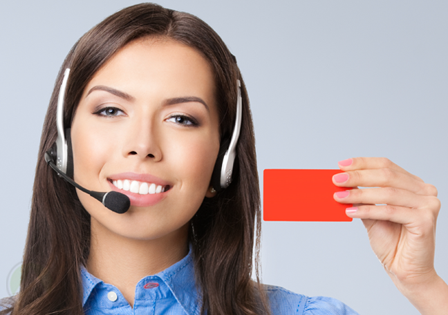 call-center-agent-holding-up-red-card