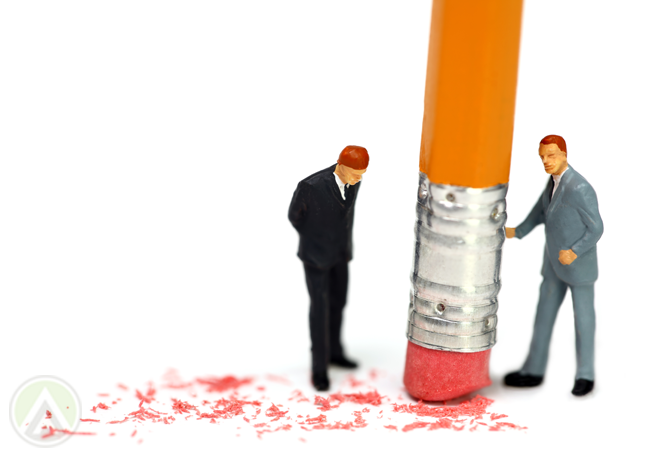 tiny-businessmen-figures-standing-by-pencil-eraser