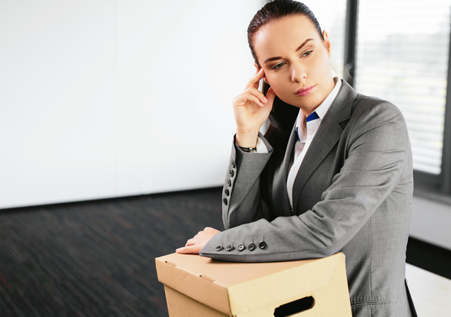 woman-in-empty-office-with-box