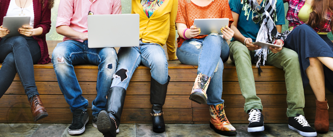young-people-sitting-holding-laptops
