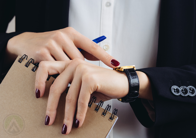 close up female executive looking at wrist watch