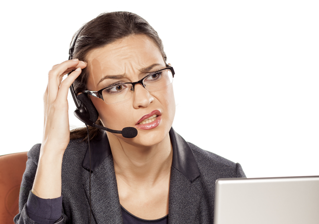 confused-call-center-agent-looking-laptop