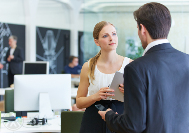 female employee chatting with boss