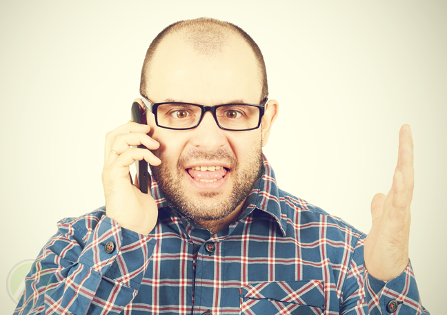 man-in-glasses-arguing-over-the-phone