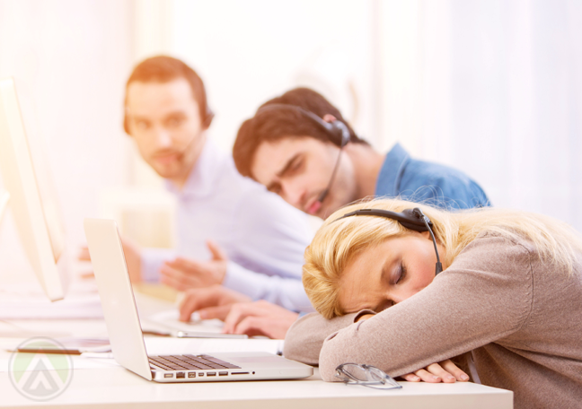 sleeping-female-customer-service-agent-call-center-coworkers-watching