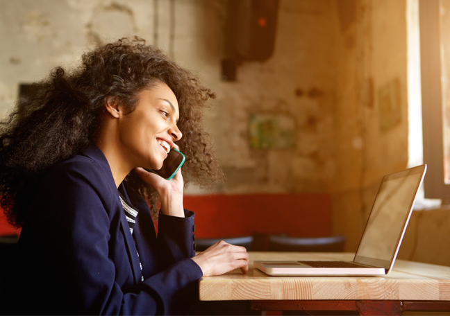woman-in-phone-call-using-laptop