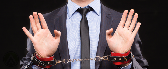 businessman held captive with handcuffs
