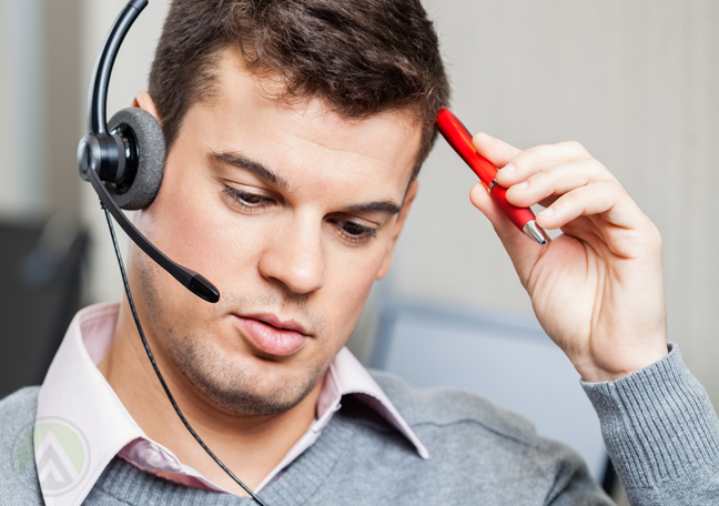 confused call center employee scratching head with pen