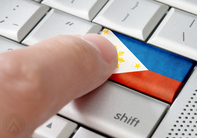 finger pushing keyboard button with Philippine flag