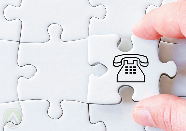 fingers-holding-white-jigsaw-piece-with-landline-telephone-drawing
