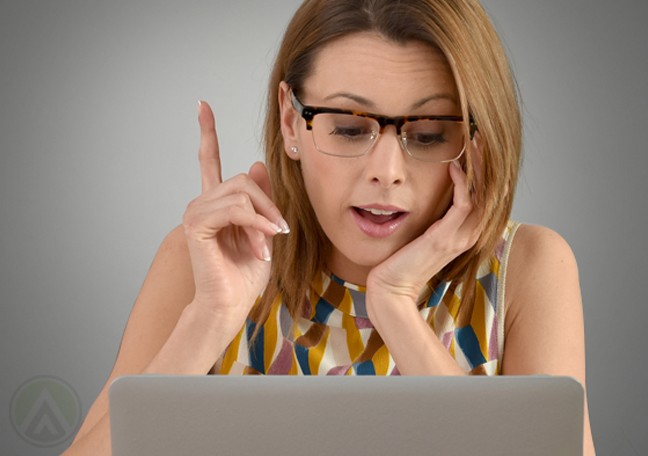 woman reading laptop pointer finger out
