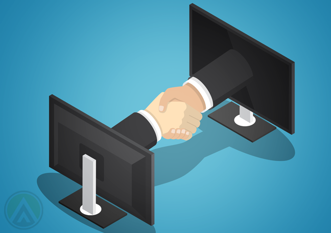 business partners handshake through computer monitors