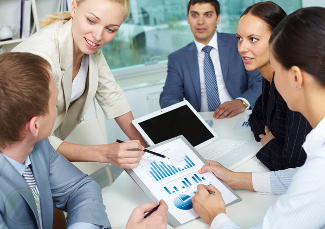 business team in meeting discussing chart reports