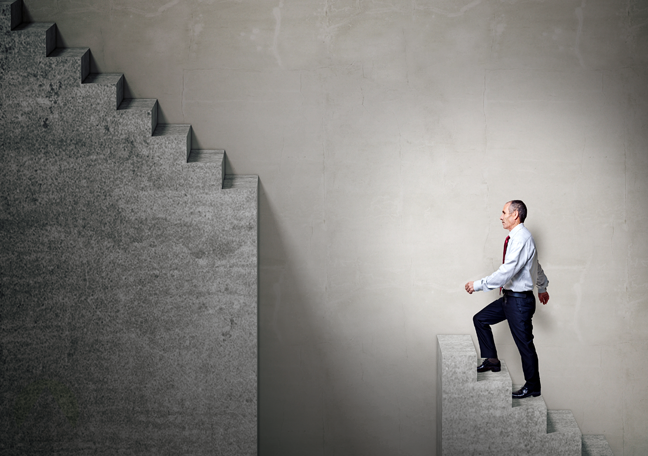 businessman climbing flight stairs missing steps
