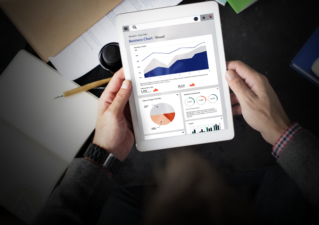 businessman holding tablet studying reports charts graphs