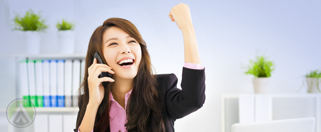 delighted female employee with fist to the air