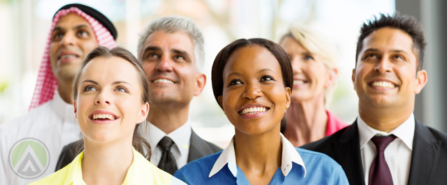 smiling racially diverse business team looking up