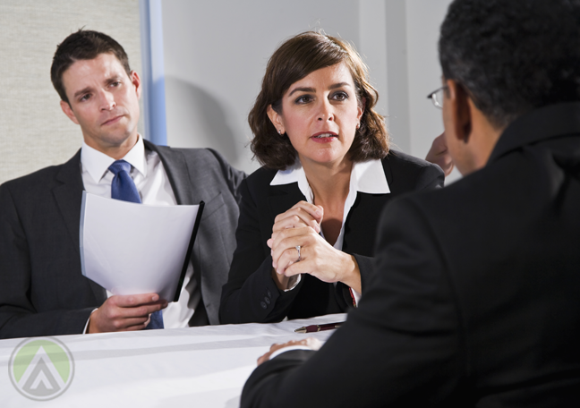business woman assistant in serious meeting with partner