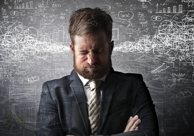 businessman holding breath surrounded by numbers calculations statistics
