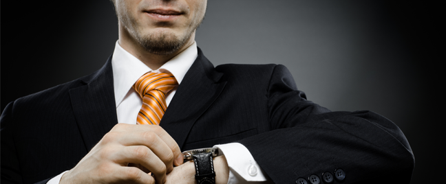 businessman holding up wristwatch