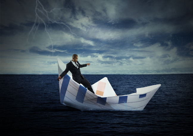 businessman sailing in paper boat troubled waters dark clouds in sky