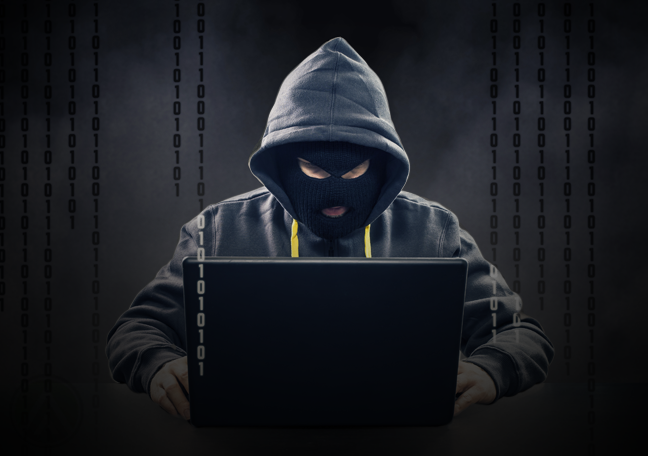 cybercriminal hacker working on laptop