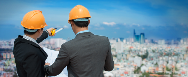 engineers looking over city scape holding construction plans