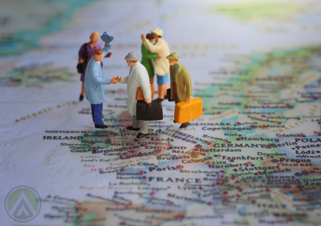 miniature-tourist-figures-standing-on-map
