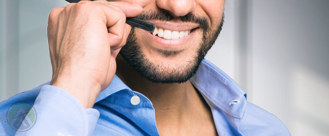 bearded smiling mouth male call center agent