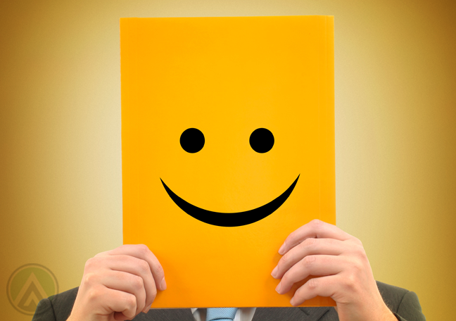 businessman holding yellow smiley