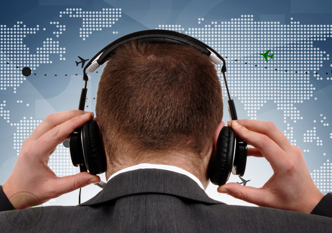 call center back behind holding headset looking at world map