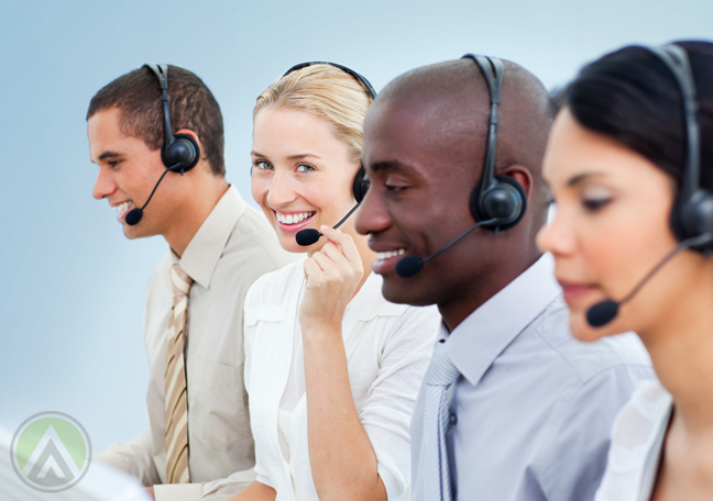 diverse customer service call center agents busy in calls